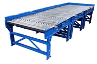 gravity roller conveyor system with skate wheel pop-up for side unloading