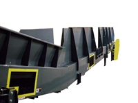 Model 661 Heavy Duty Cleated Belt Conveyor with High Siderails and Loading Gaps